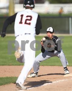 Kyle Bursaw – kbursaw@shawmedia.com  Kaneland first baseman Matt Limbrunner makes the out ahead of DeKalb's Matt Hoyle during the bottom of the seventh inning at Huntley Middle School on Monday, April 16, 2012. Kaneland won 6-2.