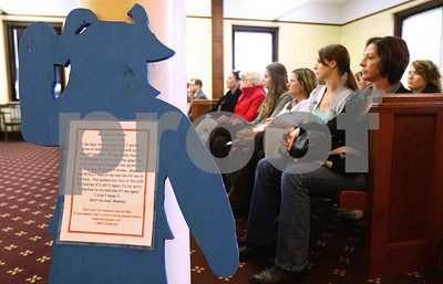 Kyle Bursaw – kbursaw@shawmedia.com  The blue silhouette of 4-year-old 'Sarah' welcomes people into one of the courtrooms inside the DeKalb County Courthouse for the Hands Around the Courthouse event on Thursday, April 26, 2012. The text, written from Sarah's perspective, tells how she spilled milk and was then hit in the face by her mother.