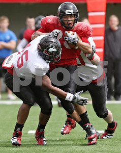 Rob Winner – rwinner@shawmedia.com  Northern Illinois running back Leighton Settle (center) powers his way to the end zone after a reception during the Huskies' spring game Saturday in DeKalb.