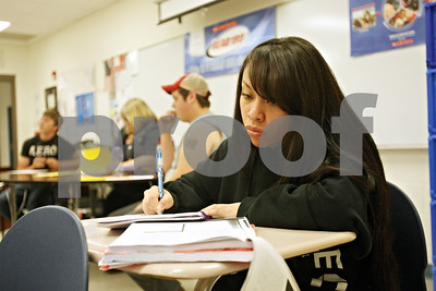 Rob Winner – rwinner@shawmedia.com  Damaris Galvan, 19, works on homework for an economics class while attending a night school class held at Genoa-Kingston High School Wednesday evening.