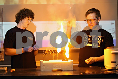 Rob Winner – rwinner@shawmedia.com  Dalton Lucas (left) and Dan Jeffries of the Northern Illinois Chemistry Club conduct a demonstration using fire during the Spring 2012 Chem Demo Night on Wednesday. This year's demo night was movie themed.