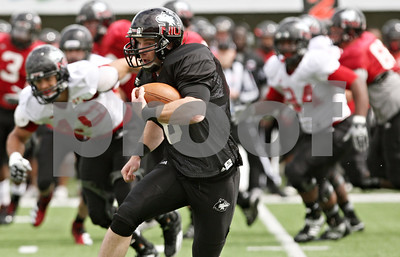 Rob Winner – rwinner@shawmedia.com  Northern Illinois quarterback Jordan Lynch carries the ball during the Huskies' spring game Saturday in DeKalb.