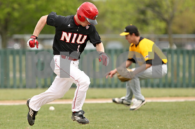 Rob Winner – rwinner@shawmedia.com  Northern Illinois batter Alex Jones (1) bunts the ball back to Milwaukee pitcher Eric King (right) for the final out of the first inning in DeKalb. Milwaukee defeated NIU, 13-2.
