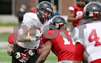 Rob Winner – rwinner@shawmedia.com  Northern Illinois tight end Kevin Tennenbaum prepares to be tackled after a reception during the Huskies' spring game Saturday in DeKalb.