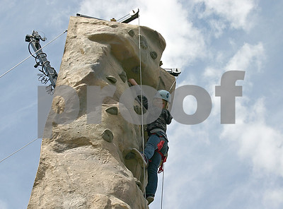 Courtney Voigt, 8, of Cortland, climbs a rock wall set up at Hopkins Park in DeKalb during the first DeKalb County Scouting Open House Sunday, which offered information about various Boy Scout, Girl Scout and Cub Scout groups.   By Nicole Weskerna - nweskerna@shawmedia.com