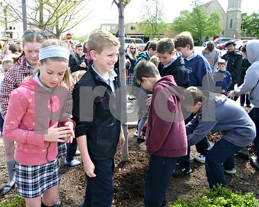 Jeff Engelhardt – jengelhardt@shawmedia.com Students from St. Mary's Catholic School in Sycamore help plant a tree near the corner of Elm and Somonauk streets in celebration of Arbor Day.