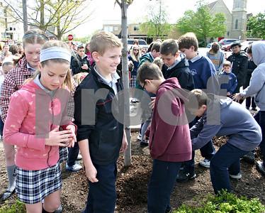 Jeff Engelhardt – jengelhardt@shawmedia.com Students from St. Mary's Catholic School in Sycamore help plant a tree near the corner of Elm and Somonauk streets in celebration of Arbor Day.
