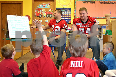 After reading a few books, Northern Illinois University football players Chandler Harnish and Adam Kiel answer questions from 5-year-olds at the Land of Learning Child Care Center in Sycamore Monday.  By Nicole Weskerna - nweskerna@shawmedia.com