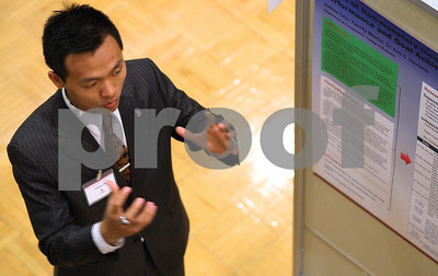 Kyle Bursaw – kbursaw@shawmedia.com  Daihee Cho, a junior accounting major at NIU and one of the Research Rookies, talks to visitors at his display during the  Undergraduate Research and Artistry Day in the Holmes Student Center at Northern Illinois University in in DeKalb, Ill. on Tuesday, April 24, 2012.