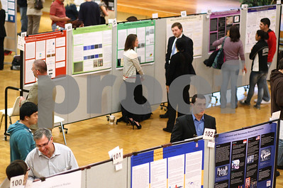 Kyle Bursaw – kbursaw@shawmedia.com  People look at and talk about the research displayed at the Undergraduate Research and Artistry Day in the Holmes Student Center at Northern Illinois University in in DeKalb, Ill. on Tuesday, April 24, 2012.