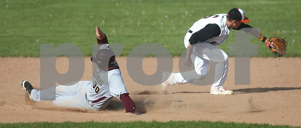 Kyle Bursaw – kbursaw@shawmedia.com  DeKalb's Kevin Sullivan reaches to make a catch as Morris' Preston Miracle slides into second base in the top of the third inning against Morris at Huntley Middle School on Monday, April 23, 2012.