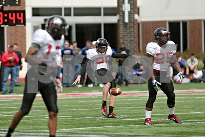 Rob Winner – rwinner@shawmedia.com  Northern Illinois punter Tyler Wedel kicks on fourth down during the Huskies' spring game Saturday in DeKalb.
