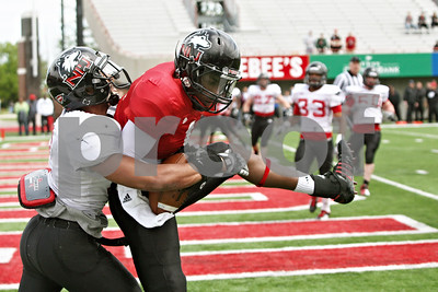 Rob Winner – rwinner@shawmedia.com  Northern Illinois cornerback Sean Evans (left) is unable to break up a touchdown pass held on by wide receiver Martel Moore during the Huskies' spring game Saturday in DeKalb.