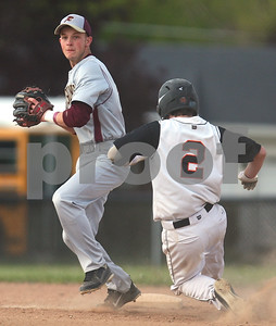 Kyle Bursaw – kbursaw@shawmedia.com  Morris' Kenny Milosovic makes a throw to first after getting out DeKalb's Jared Johnson at second base in the bottom of the first inning against Morris at Huntley Middle School on Monday, April 23, 2012.
