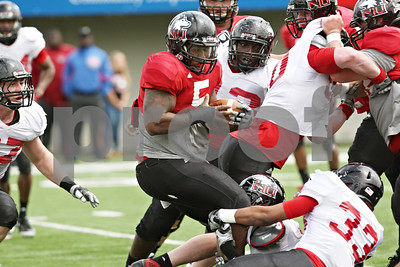Rob Winner – rwinner@shawmedia.com  Northern Illinois running back Jamal Womble (5) carries the ball during the Huskies' spring game Saturday in DeKalb.