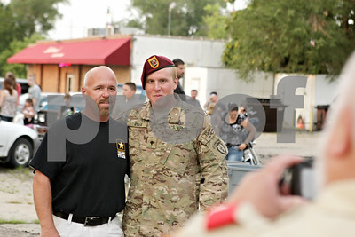 Rob Winner – rwinner@shawmedia.com  Army Spc. Tyler Ryan (right) poses for a photograph with his father Mike Ryan outside Sullivan's Tarvern in DeKalb Tuesday night.