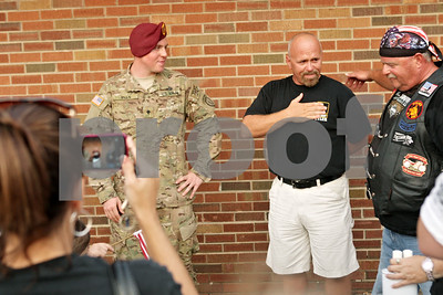 Rob Winner – rwinner@shawmedia.com  Army Spc. Tyler Ryan (left) and his father  Mike Ryan thank supporters outside Sullivan's Tavern in DeKalb Tuesday.