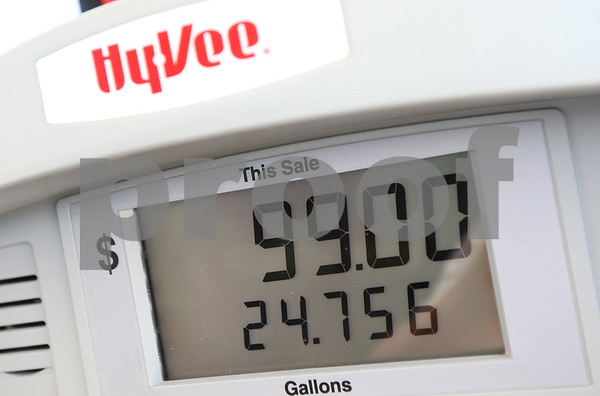 Kyle Bursaw – kbursaw@shawmedia.com<br /> <br /> MichaelAngelo Alvarez, of Galena, Ill. puts a little less than 25 gallons of gas in his tank at Hy-Vee, which came to a total of $99.00 on Monday, Aug. 6, 2012.
