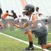 Kyle Bursaw – kbursaw@shawmedia.com<br /> <br /> DeKalb's Jimmy Russell snaps the ball for a drill at practice on Wednesday, Aug. 8, 2012.
