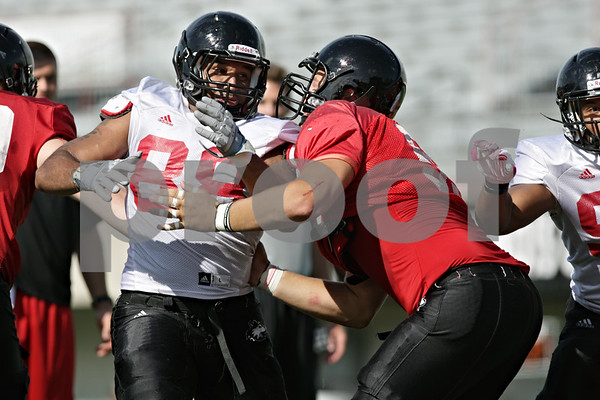 Rob Winner – rwinner@shawmedia.com<br /> <br /> Northern Illinois defensive end Sean Progar (left) goes up against Andrew Ness during practice at Huskie Stadium in DeKalb, Ill., on Friday, Aug. 10, 2012.