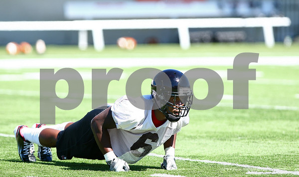 Kyle Bursaw – kbursaw@shawmedia.com<br /> <br /> Linebacker Jamaal Bass does pushups during practice at Huskie Stadium on Monday, Aug. 6, 2012.