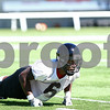 Kyle Bursaw – kbursaw@shawmedia.com<br /> <br /> Linebacker Jamaal Bass does pushups during practice at Huskie Stadium on Monday, Aug. 6, 2012.