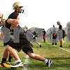 Kyle Bursaw – kbursaw@shawmedia.com<br /> <br /> During a punt coverage drill, Sycamore's Austin Culton gets around teammate Michael Stinnett at the line during practice on Wednesday, Aug. 8, 2012.