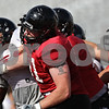 Rob Winner – rwinner@shawmedia.com<br /> <br /> Northern Illinois offensive lineman Aidan Conlon participates in a blocking drill during practice at Huskie Stadium in DeKalb, Ill., on Friday, Aug. 10, 2012.