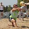 Rob Winner – rwinner@shawmedia.com<br /> <br /> Sycamore resident Shannon O'Keefe attempts to bump a ball during a sand volleyball tournament outside Four Seasons Sports in Sycamore Saturday afternoon.  DeKalb Firefighters from the International Association of Fire Fighters Local 1236 hosted the sand volleyball tournament to benefit the Muscular Dystrophy Association.