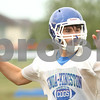 Kyle Bursaw – kbursaw@shawmedia.com<br /> <br /> Genoa-Kingston quarterback Adam Price searches for an open receiver during a seven-on-seven at practice on Thursday, Aug. 9, 2012.