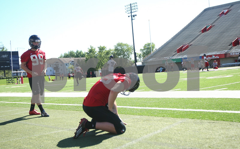Kyle Bursaw – kbursaw@shawmedia.com<br /> <br /> Northern Illinois kicker Mathew Sims (99) lines up to kick while Ryan Neir (18)  waits to receive the snap during practice at Huskie Stadium on Monday, Aug. 6, 2012.