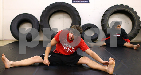 Kyle Bursaw – kbursaw@shawmedia.com<br /> <br /> Nate Beach, 20, stretches out at the beginning of a training session at United Mixed Martial Arts & Fitness in DeKalb on Tuesday, July 24, 2012. Beach has a featherweight title fight on August 18th at the Outdoor War event in Island Lake, Ill.