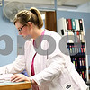 Kyle Bursaw – kbursaw@shawmedia.com<br /> <br /> Falon Larson, a registered nurse at Oak Crest Retirement Center, gets prescriptions pulled and ready for their recipients to take in the evening on Tuesday, Aug. 7, 2012.