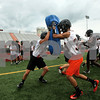 Kyle Bursaw – kbursaw@shawmedia.com<br /> <br /> DeKalb players Anthony Szula (front left) and Lee Parrish (front right) collide running a drill at practice on Wednesday, Aug. 8, 2012.