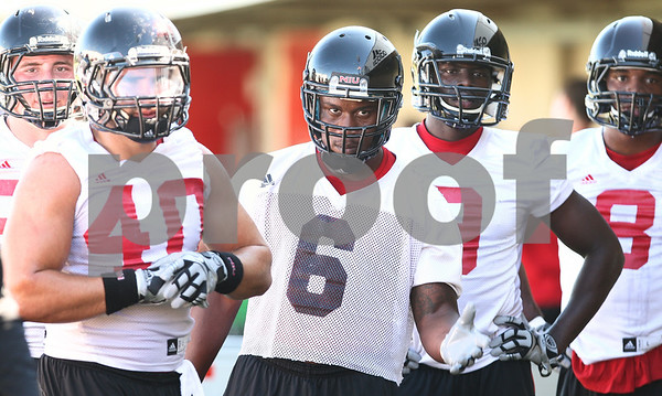 Kyle Bursaw – kbursaw@shawmedia.com<br /> <br /> Northern Illinois linebackers including Victor Jacques (40) and Jamaal Bass (6) listen to one of the coaches during practice at Huskie Stadium on Monday, Aug. 6, 2012