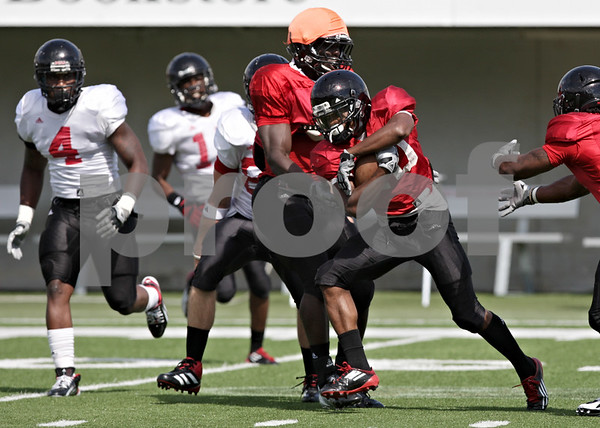 Rob Winner – rwinner@shawmedia.com<br /> <br /> Northern Illinois wide receiver Tommylee Lewis carries the ball after receiving a punt during practice at Huskie Stadium in DeKalb, Ill., on Friday, Aug. 10, 2012.