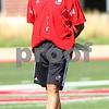 Kyle Bursaw – kbursaw@shawmedia.com<br /> <br /> Northern Illinois head coach Dave Doeren patrols the field during practice at Huskie Stadium on Monday, Aug. 6, 2012
