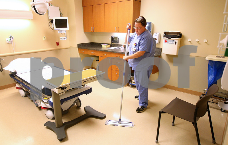 ***NOTE: Hold until expansion is officially open***<br /> <br /> Kyle Bursaw – kbursaw@shawmedia.com<br /> <br /> Housekeeper Desirae Story mops the floor in one of the 10 treatment rooms in the expansion to the E.R. department at Kishwaukee Community Hospital on Tuesday, Aug. 7, 2012.