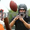Kyle Bursaw – kbursaw@shawmedia.com<br /> <br /> DeKalb quarterback Jack Sauter takes a snap at practice on Wednesday, Aug. 8, 2012.