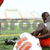 Kyle Bursaw – kbursaw@shawmedia.com<br /> <br /> DeKalb's Justin Bell talks to a teammate while putting on his shoes prior to practice on Wednesday, Aug. 8, 2012.