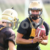 Kyle Bursaw – kbursaw@shawmedia.com<br /> <br /> Sycamore quarterback Devin Mottet looks to handoff at practice on Wednesday, Aug. 8, 2012.