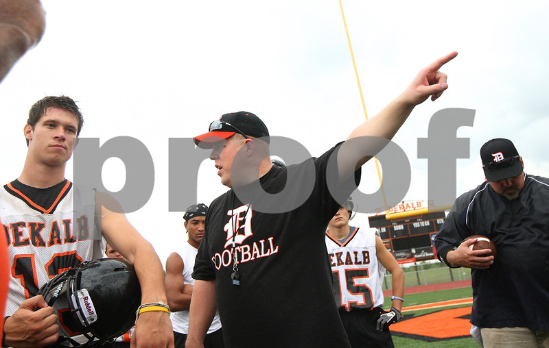 Kyle Bursaw – kbursaw@shawmedia.com<br /> <br /> DeKalb head coach Todd Hallaron directs his players to their next activity during practice on Wednesday, Aug. 8, 2012.