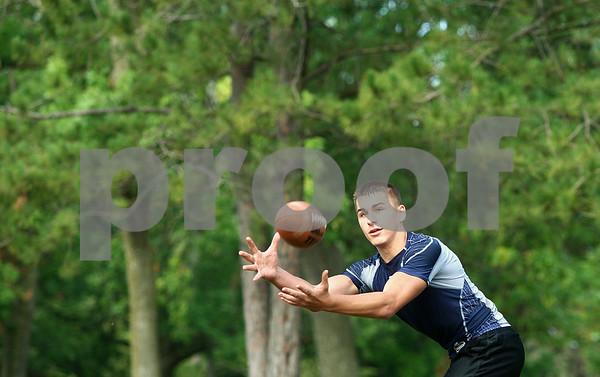 Kyle Bursaw – kbursaw@shawmedia.com<br /> <br /> Hiawatha tight end Allen Letterer III brings one in at pratice on Thursday, Aug. 9, 2012.
