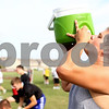 Kyle Bursaw – kbursaw@shawmedia.com<br /> <br /> Sycamore's Evan Short hydrates during a short break at football practice on Wednesday, Aug. 8, 2012.