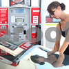Kyle Bursaw – kbursaw@shawmedia.com<br /> <br /> Hannah Brennan, 18, from Hinckley, fills up her tank at Hy-Vee in Sycamore on her way home from work on Monday, Aug. 6, 2012.