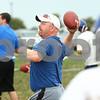 Kyle Bursaw – kbursaw@shawmedia.com<br /> <br /> Genoa-Kingston coach Travis Frederick throws passes during a drill at practice on Thursday, Aug. 9, 2012.