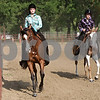 Rob Winner – rwinner@shawmedia.com<br /> <br /> Nicole Siuda (left), 17 of Sycamore, and Ashley Black, 17 of Cortland, compete in the Bareback Horsemanship class during the DeKalb County 4-H Fair at the Sandwich Fairgrounds Saturday.