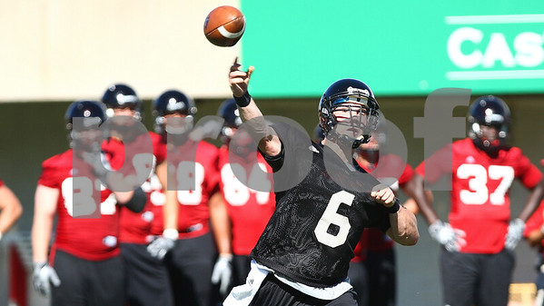 Kyle Bursaw – kbursaw@shawmedia.com<br /> <br /> Northern Illinois quarterback Jordan Lynch (6) throws during practice at Huskie Stadium on Monday, Aug. 6, 2012.