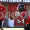Kyle Bursaw – kbursaw@shawmedia.com<br /> <br /> Northern Illinois running back Akeem Daniels (3) tosses the ball back to a coach at the end of a play during practice on Monday, Aug. 6, 2012