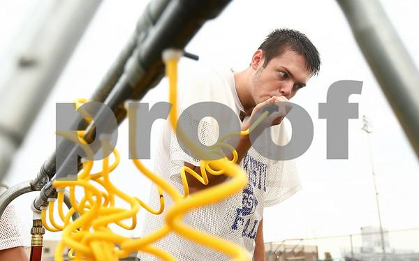 Kyle Bursaw – kbursaw@shawmedia.com<br /> <br /> Genoa-Kingston tight end Cameron Badenoch grabs some water at practice on Thursday, Aug. 9, 2012
